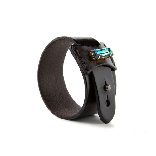 Minimalist PU leather wide cuff bracelet made of quality artificial leather material, featuring a bold Swarovski crystal.